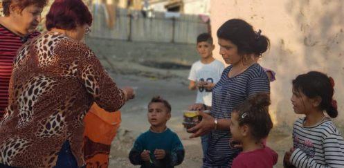Actiune de caritate a beneficiarilor ADMIS in comunitatea defavorizata din Harsova